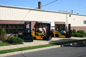 forklifts out front of a building